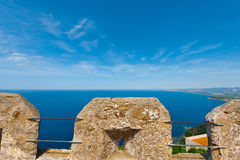 Mediterranean Sea. Views of the Mediterranean Sea through the Battlements of a Medieval Fortress in Italy Stock Photography