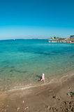 Mediterranean sea waterfront with child in water Royalty Free Stock Photos