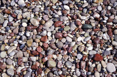 Mediterranean sea wet pebbles beautiful nature background Royalty Free Stock Images