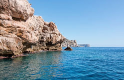 Mediterranean seascape. With azure ocean water, horizon and rocky coast outside Sant Elm, Mallorca, Spain Royalty Free Stock Photos