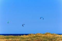 Mediterranean seascape with kite flying Stock Photos