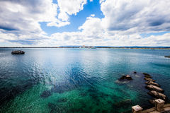 Mediterranean seascape sea and sky. Blue deep green. Terrace. Stock Photos