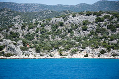 Mediterranean seascape shut on sunny day. From sea with mountains and evergreen plants Stock Image