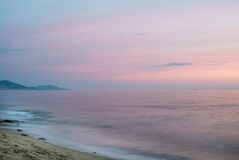 Mediterranean seascape at sunset with mountains on a background. Stock Photography