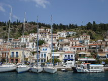 Mediterranean seaside island town of Poros Greece. Boats and buildings on hillside Mediterranean seaside Greek island town of Poros Greece royalty free stock photo