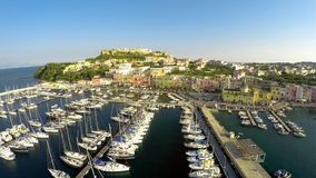 Mediterranean seaside town aerial shot, boats docked in port, summer vacation. Stock photo stock photography
