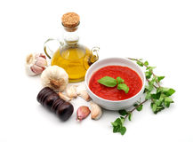 Mediterranean seasoning. Olive oil, tomato, garlic and oregano isolated over white Stock Photos