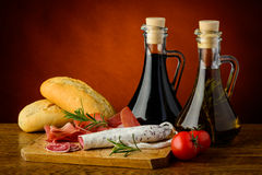 Mediterranean snack. With ham, salami, bread, tomatoes and olive oil Royalty Free Stock Photography