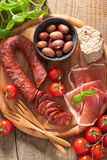 Mediterranean snack chorizo parma olives tomatoes Stock Images
