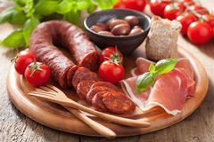 Mediterranean snack chorizo parma olives tomatoes Stock Photography