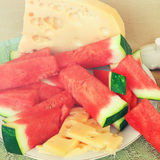 Mediterranean in snack country style. Watermelon, cheese and cottage cheese for snack or dessert. Mediterranean country style . Farm natural food for lunch or Stock Photos