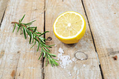 Mediterranean spices. Rosemary, lemon and sea salt on wooden background Royalty Free Stock Image