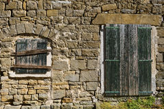 Mediterranean Stone Building Facade. Wall of a worn down traditional mediterranean stone house Stock Photography