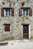 Mediterranean Stone House. Front view of a traditional mediterranean residential stone house Stock Image