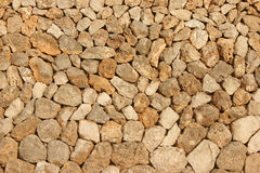 Mediterranean stone wall. Background of a brown mediterranean stone wall Stock Photo