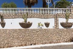 Mediterranean stone wall with cactus. In Portugal Stock Photo