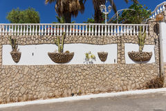 Mediterranean stone wall with cactus. In Portugal Royalty Free Stock Photo
