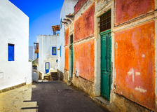 Mediterranean street with colorful walls and doors and windows. Mediterranean street with colorful walls, doors and windows, Sicily Stock Photo