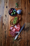 Mediterranean-Style Antipasto on Wooden Board Stock Image