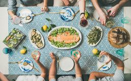 Mediterranean style dinner with cooked salmon, bread, lemonade stock photos