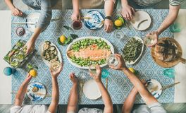 Mediterranean style dinner with cooked salmon and drinks royalty free stock photo