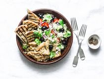 Mediterranean style lunch - couscous, cherry tomatoes, cucumbers, feta cheese, olives salad and lemon herbs roasted chicken breast royalty free stock photo