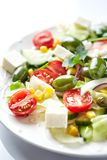 Mediterranean-style Salad with Green Olives, Feta Cheese, Cucumber, Cherry Tomatoes and Capers. stock photos
