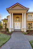 Mediterranean style waterfront home with columned porch. Mediterranean style luxury waterfront home boasts elegant high ceiling columned porch and stucco Royalty Free Stock Photography