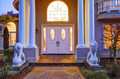 Mediterranean style waterfront home with columned porch Royalty Free Stock Image