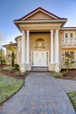 Mediterranean style waterfront home with stucco walls and columned porch Stock Photography