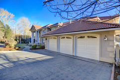 Mediterranean style waterfront home with three garage spaces Stock Photo