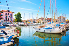 Mediterranean summer scene with boats in harbor stock photo