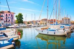 Mediterranean summer scene with boats in harbor. Beautiful scene of boats lying in the harbor of Grado, Italy at Adriatic Sea stock photo