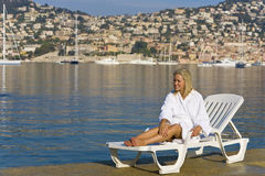 Mediterranean Sunbed. A beautiful young woman sunbathing in a Mediterranean resort Stock Images