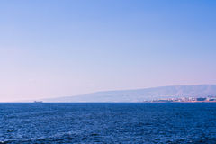 Mediterranean sunset. With mountain and ship far away royalty free stock photography