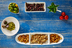 Mediterranean tapas black olives capers and nuts Royalty Free Stock Photography