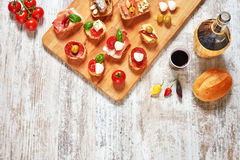 Mediterranean tapas and red wine on a wooden table Royalty Free Stock Image