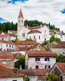 Mediterranean town with a church on top of a hill Stock Photo