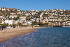 Mediterranean town Roses, Spain. ROSES, SPAIN - MAY 27: Beach and city view of mediterranean town Roses. May 27, 2015 in Catalonia, Spain Stock Photo