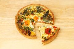 Quiche on a chopping board Stock Photography