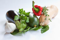 Mediterranean Vegetables. Including, aubergine, courgette, pepper, butternut squash, garlic and herbs Stock Photos