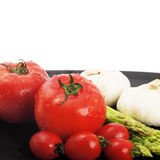 Mediterranean vegetables. Plate of fresh tomatoes ;cherry tomatoes asparagus and garlic ,typical mediterranean food Stock Photos