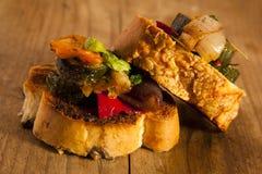Mediterranean vegetables on bread. Stock Image
