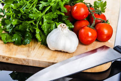 Mediterranean vegetables and knife on a cutting board Stock Photo