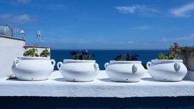 Mediterranean flower pot. White flower pot on mediterranean terrace Stock Photo