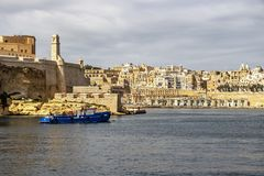 View to part of Fort St. Angelo in Birgu and Valletta with Quarry Wharf, at Grand Harbor, Malta. Mediterranean view with a ship, part of Fort St. Angelo in Birgu Stock Photography