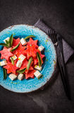 Mediterranean watermelon, feta cheese and mint salad on blue plate. Stock Image