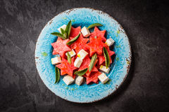 Mediterranean watermelon, feta cheese and mint salad on blue plate. Royalty Free Stock Photo