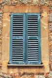 Rustic Mediterranean closed shutters Stock Photo