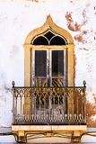 Mediterranean window with iron balcony Royalty Free Stock Photography